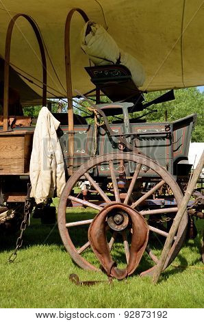 The top has been removed from a covered wagon will of artifacts of the post Civil War era. poster