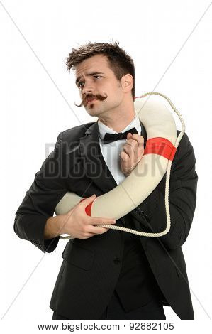 Young businessman struggling to fit into life ring isolated over white background