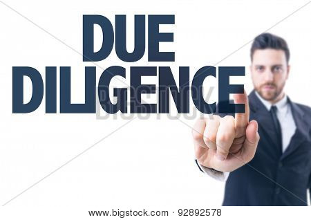 Business man pointing the text: Due Diligence