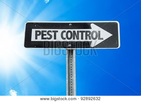 Pest Control direction sign with a beautiful day