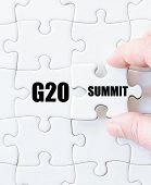 Last puzzle piece with word G20 SUMMIT. Concept image poster