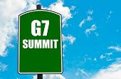G7 SUMMIT written on green road sign against clear blue sky background. Concept image with available copy space poster