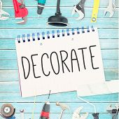 The word decorate against tools and notepad on wooden background poster