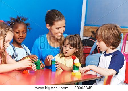 Children playing in child care in after-school care club