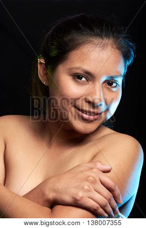 young latino girl portrait isolated on black background poster