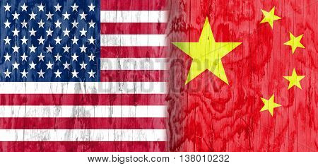 Image relative to politic relationships between United States and China. National flags textured by wood