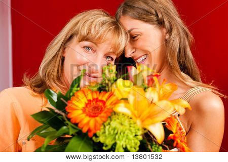 Mother and daughter � the daughter has given her mother flowers