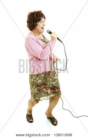 Female impersonator does impression of middle-aged singer.  Full body isolated on white.