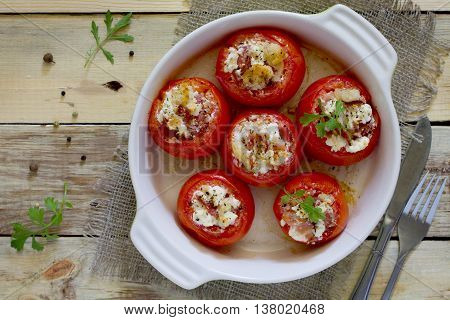 Baked Stuffed Tomatoes With Bacon And Feta Cheese On The Table In A Rustic Style. Top View .