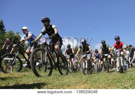 Mass Bikers Cycling In The Mountain