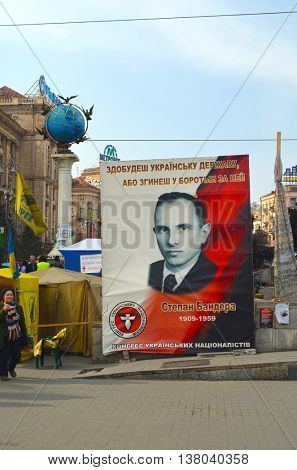 KIEV, UKRAINE - Mar 24, 2014: Stephan Bandera poster (Ukrainian nationalist icon ) near Burnt down the House of trade unions.Riot in Kiev.March 24, 2014 Kiev, Ukraine