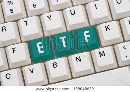 Exchange Traded Funds online A close-up of a keyboard with teal highlighted text ETF