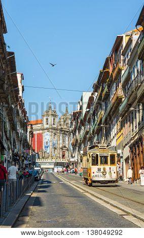 Tram Near To Santo Ildefonso Church In Porto. Portugal.