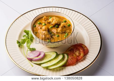 gobi masala, gobi mutter curry or gobi fry , cauliflower mutter curry, indian food, lunch ,dinner, served with green salad, tomato, onion, cucumber and green chilly