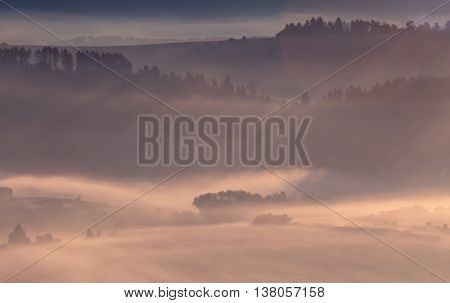 Morning fog in the Alps, mountain landscape
