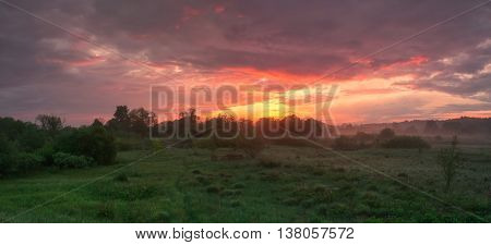 Foggy morning landscape, colorful cloudy summer sky