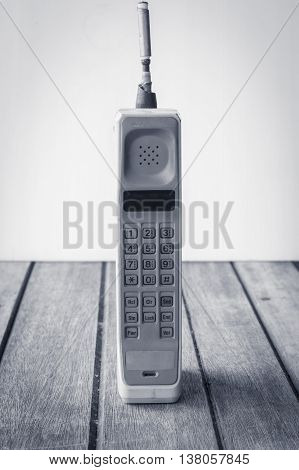 1980s, old, phone, move, dirty, nobody, white, business, shot, telephone, studio, obsolete, vertical, revival, gray, technology, equipment, object, number, retro, old-fashioned, mobility, mobile, desk, cut, clunky, medium, outdoors, 1990s, global, antique