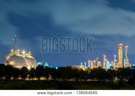 Landscape of sphere tank of storage gas and liquid chemical in oil refinery factory at night