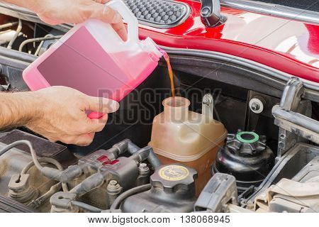 pink car coolant service in engine case