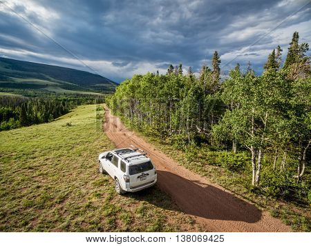 RED FEATHER LAKES, CO, USA - JUNE 3, 2016: Toyota 4Runner SUV (2016 Trail edition) on a back country road in Colorado's Rocky Mountains - aerial view