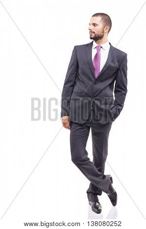Young business man standing looking at copyspace, isolated on white background