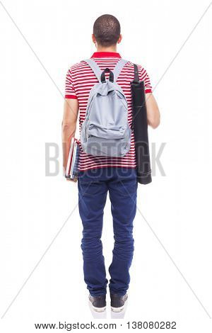 Rear view of male student standing with backpack and notebooks on white background