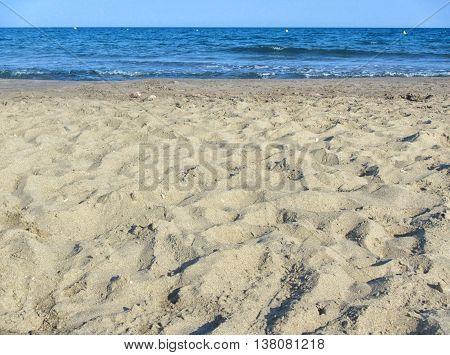 Sand beach and sea. Sunny day light