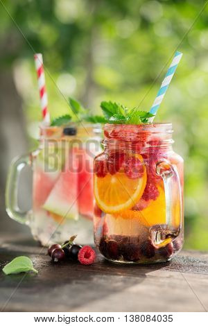 Ice refreshing summer drink on blurred background. Healthy food, diet and cooking concept.