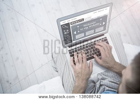 Composite image of website interface against overhead view of a man using laptop in living room