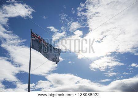 the Australian flag in the blue sky