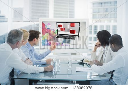 A laptop with graphic background against business people looking at blank whiteboard in conference room