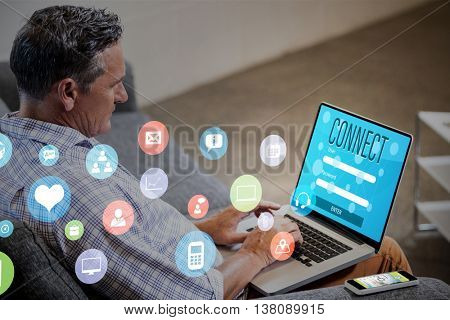 Colourful icons against profile view of a businessman working on computer