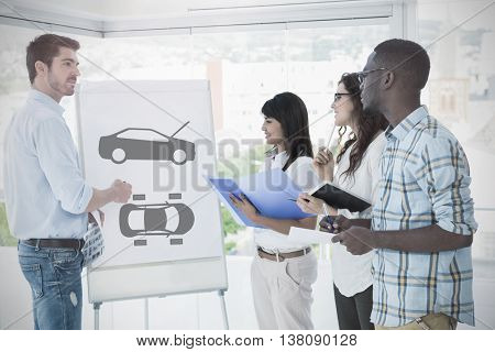 car diagram against man presenting and coworkers taking notes