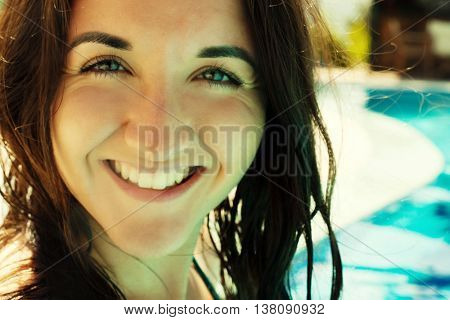 young woman smiling in a swimming pool