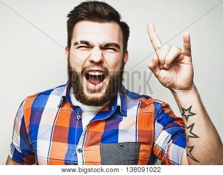 bearded man showing heavy gesture