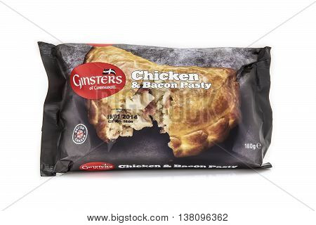 SWINDON UK - JANUARY 12 2014: Ginsters Chicken and Bacon pasty on a white background Ginsters is a company based in Callington in Cornwall in the south-west of England. The biggest selling pasty maker in the UK