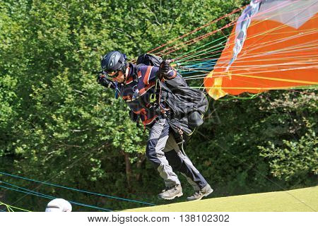 Paraglider running to do a forward launch