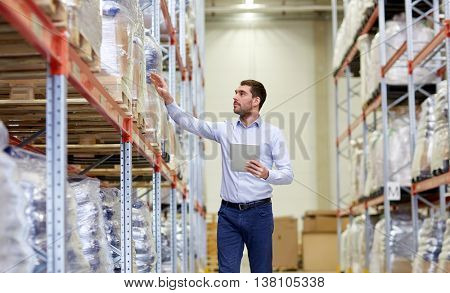 wholesale, logistic, business, export and people concept - man or manager with tablet pc computer checking goods at warehouse