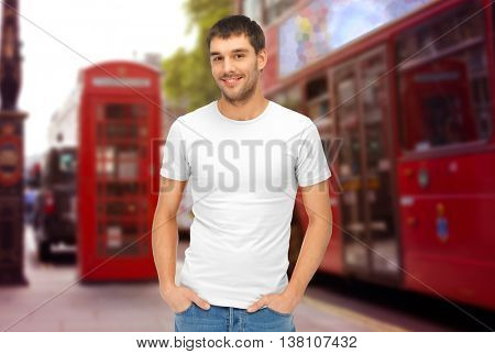 travel, tourism and people concept - handsome man in blank white t-shirt over london city street background