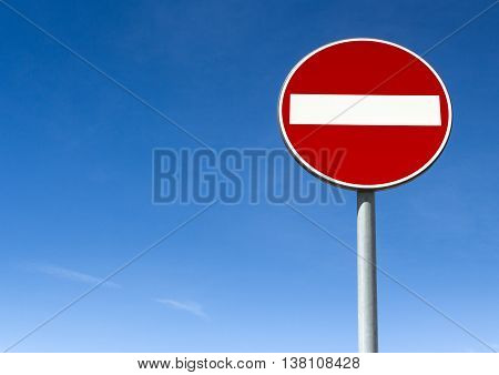 Road sign ban of access against the blue sky with copy space.
