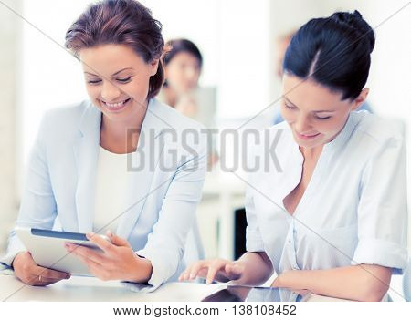 smiling business team working with tablet pc in office
