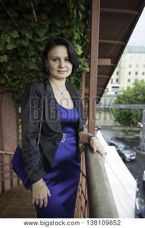 Portrait of a mature businesswoman in a blue evening dress.