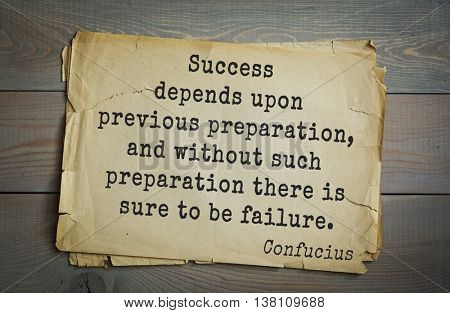 Ancient chinese philosopher Confucius quote on old paper background. Success depends upon previous preparation, and without such preparation there is sure to be failure.
