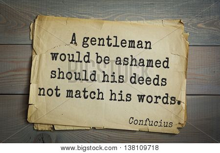 Ancient chinese philosopher Confucius quote on old paper background. A gentleman would be ashamed should his deeds not match his words.