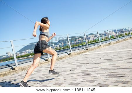 Woman running at city