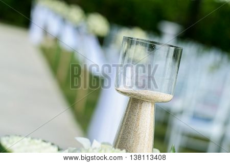 Sand in the bottle to used for wedding ceremonies close up object and blur background