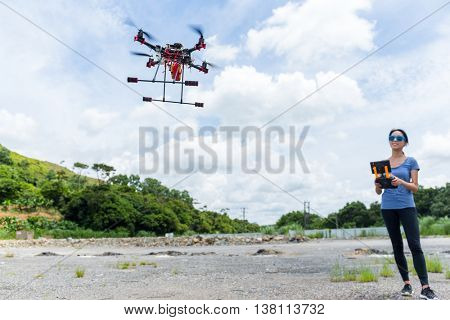 Woman controling with drone