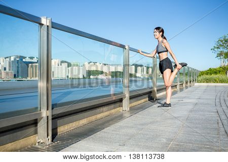 Woman doing warm up exercise before running