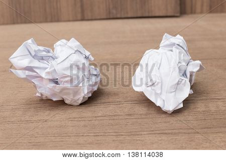 paper ball white sheet crumpled lumpy on wooden floor background