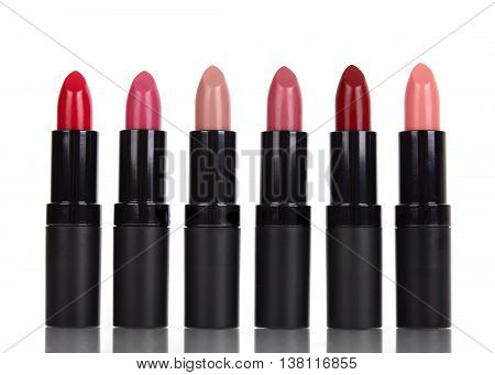 Lipstick make up isolated on a reflective white background